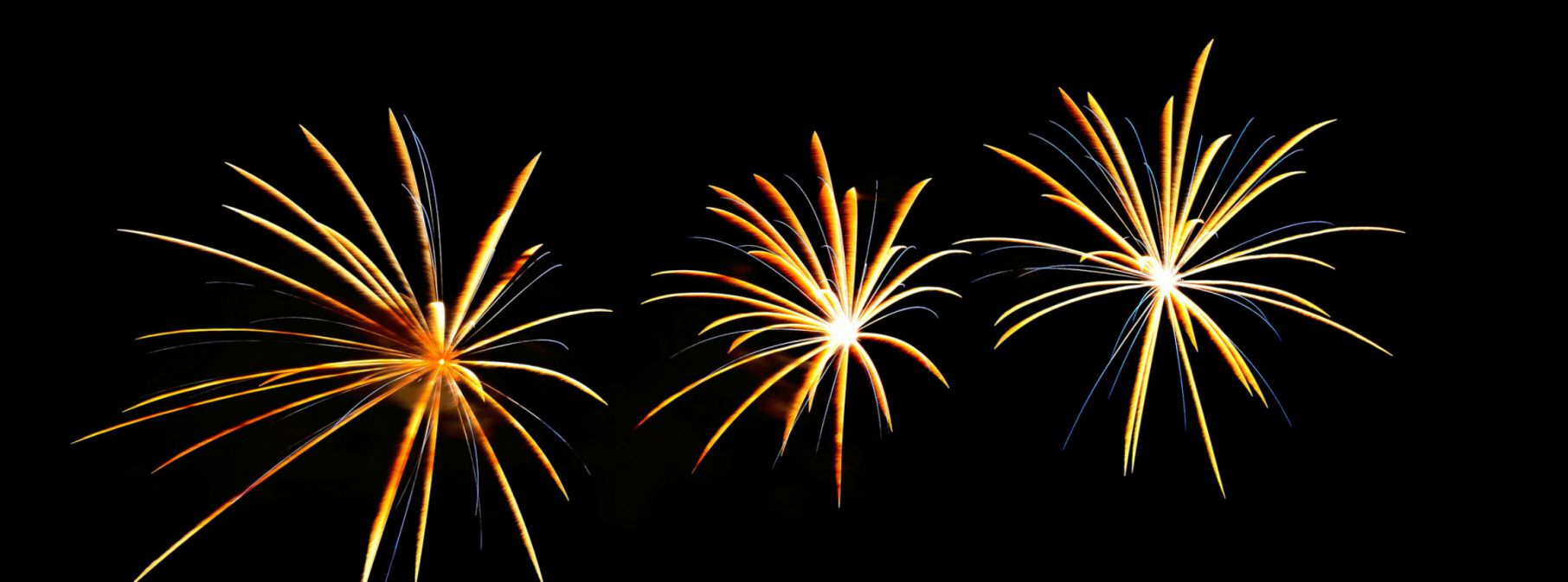 yellow and blue firework bursts