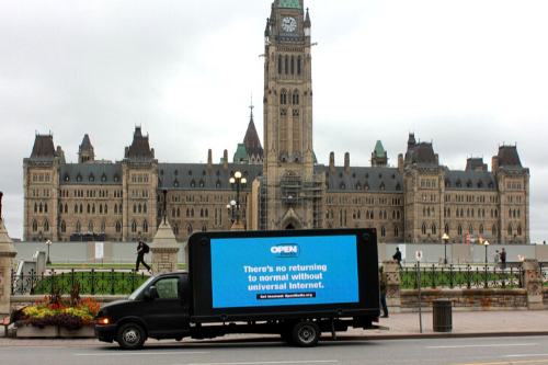 Truck with billboard: There's no returning to normal without universal internet